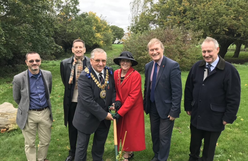 Sir David plants donated tree in local park